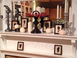 decorating lovely black metal fireplace candelabra with ten white