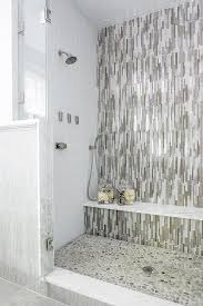 gray and taupe glass shower tiles with marble shower bench