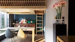 ncda designs wood screened loft bedroom for tiny hong kong treehouse