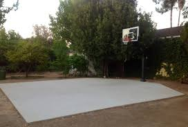 pro dunk gold basketball system and an exceptional concrete slab
