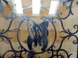 designer signed wrought iron glass art nouveau bear theme coffee