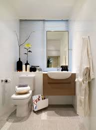 bathroom towel rack design with wall mirror and small bathroom