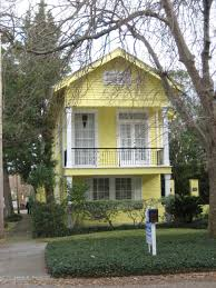 architecture natural shotgun house with cool soft yellow exterior