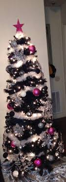 white tree with pink and black gold ornaments
