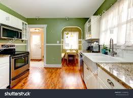 bright kitchen room green wall hardwood stock photo 177680402