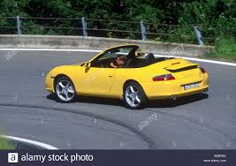 yellow porsche 911 car porsche 911 carrera convertible model year 2001 yellow
