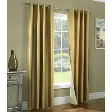 golden brown drapery basement window curtains and glass windows on