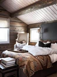 rustic bedrooms with wood beams and tin ceiling and wood paneling
