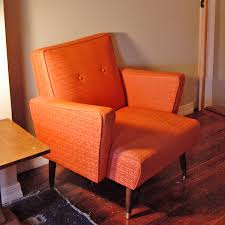 mid century modern chair orange too many chairs in this room