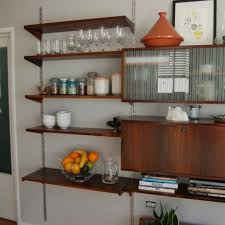 Wrought Iron Wall Shelves Brick Wall Kitchen Ideas With Beige Together With Black Wrought