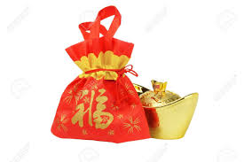 bag new year new year gift bag and gold inpgot ornament on white