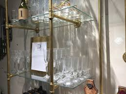 gas pipe shelving unit paint gold and add glass shelves style