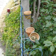 Hanging Flower Pot Hooks Wire Hangers Twisted Into Pot Holders Hide Chainlink Fence With