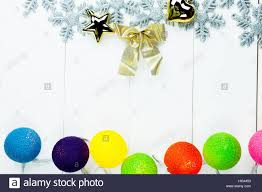 themed ornaments and colorful lights on white clean