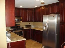 dark oak cabinets kitchen with dark flooring precious home design