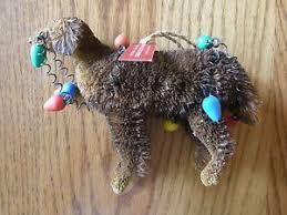 pottery barn chocolate lab dog with tangled christmas lights