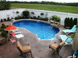 decor small inground pool with chairs and cute waterfall for