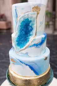 picture of two trends in one u2013 a bold blue marble wedding cake