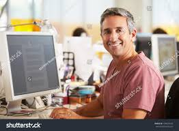 man working desk busy creative office stock photo 130607543