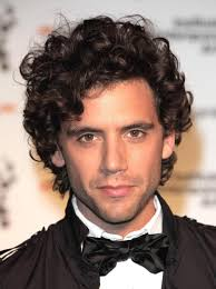 haircut styles for curly hair men mika handsome scruffy young man with curly hair hairstyles to