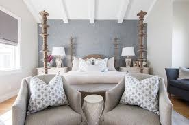 Grey Bedroom Chair by Gray Linen Bedroom Chairs With Blue Pillows Placed At Foot Of Bed