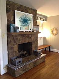 painting a stone fireplace by paper fox