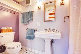 lavender walls bathroom with white appliances detached guest