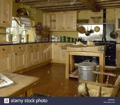 yellow kitchen wood cabinets country yellow kitchen with beamed ceiling wooden cabinets