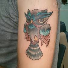 color small owl on biceps
