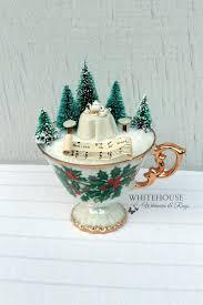 a tea cup garden with a tiny tea setting for