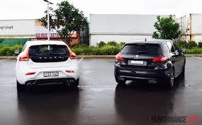 compare peugeot cars 2015 volvo v40 t5 vs peugeot 308 gt warm hatch comparison video