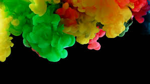 colorful rainbow paint drops from bottom mixing in water ink