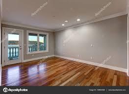 empty room pictures empty room with hardwood floor and door to balcony u2014 stock photo