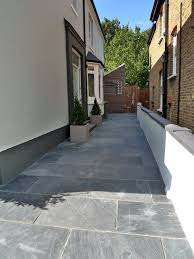 Interlocking Slate Patio Tiles by Low Maintenance Double Driveway And Garden Entrance In Dark