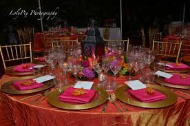 garden wedding reception decoration ideas round table with red tablecloth combined by colorful flower and