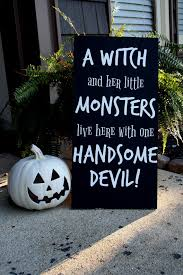 a witch and her little monsters live here with one handsome devil