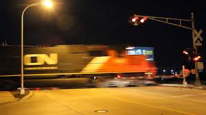 traffic light mt clemens cn sd60 flies north w intermodal train l533 in mount clemens mi