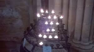 light a candle for someone pray for someone and light a candle picture of wells cathedral