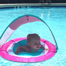 Swimways Baby Spring Float Sun Canopy Blue by Teaching Your Baby To Swim With Swimways Anchored Mommy