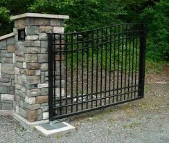 matching dual operating driveway gate with ornamental and