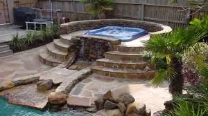 paver patio with natural gas fire pit two columns and sitting wall