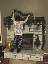How To Decorate A Stone by How To Decorate A Narrow Stone Mantel For Christmas In 5 Minutes