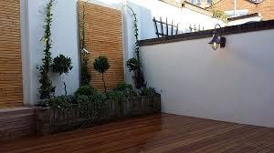 garden ideas with decking and grass margarite gardens