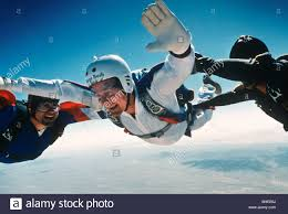 president george h w bush free falls during a parachute jump to
