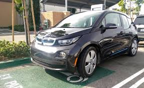 how to charge a bmw car battery bmw i3 gets improved trip planning free fast charging