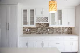 white glass backsplash painting pine cabinets labor cost to
