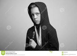 hoods haircutgame teenage bad boy with slingshot and stylish haircut studio shot
