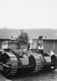 french renault tank german soldier sitting on the armor of light captured by the