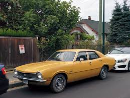 4 Door Muscle Cars - old parked cars vancouver 1971 ford maverick 4 door