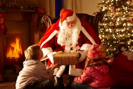 father christmas giving gift to children in grotto santas grotto